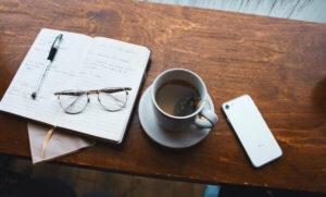 Note pad, glasses, phone